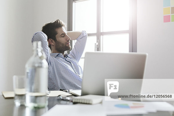 Young businessman working in office  taking a break