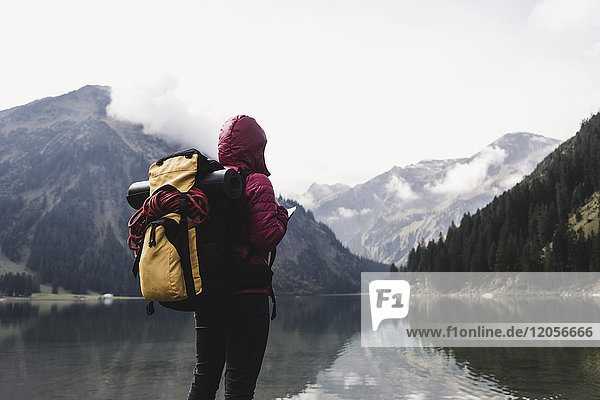 Austria  Tyrol  Alps  hiker standing at mountain lake