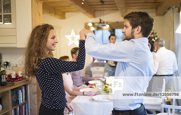Young couple dancing on a Christmas party