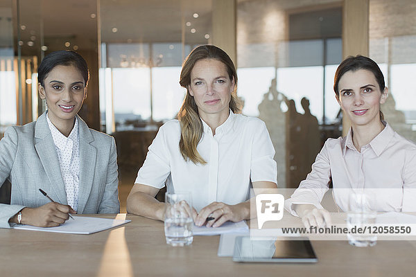 Portrait smiling  confident businesswomen working in conference room meeting