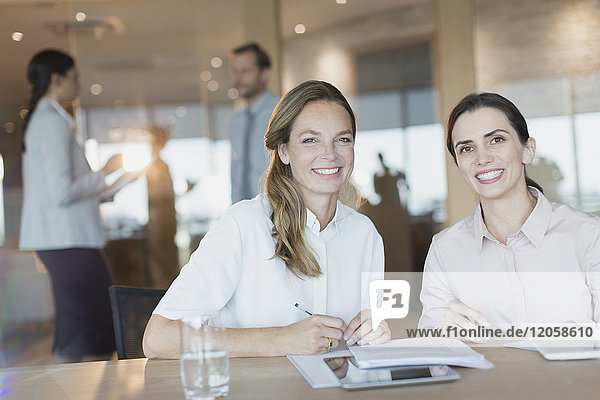 Portrait smiling  confident businesswomen in conference room meeting