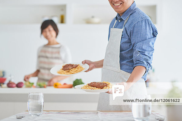 Japanese couple cooking together in the kitchen
