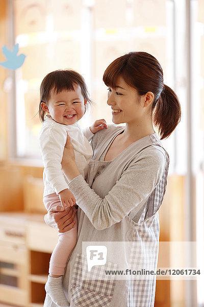 Teacher with kid at Japanese kindergarten