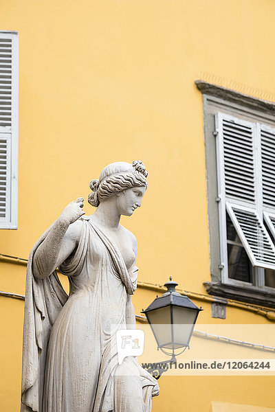 Statue in front of residential building  Lucca  Tuscany  Italy
