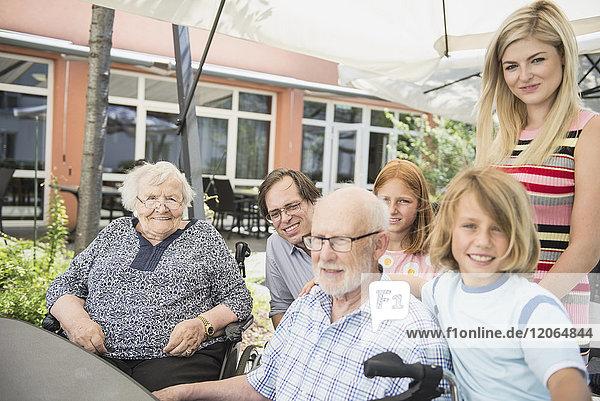 Portrait of multi-generation family at nursing home