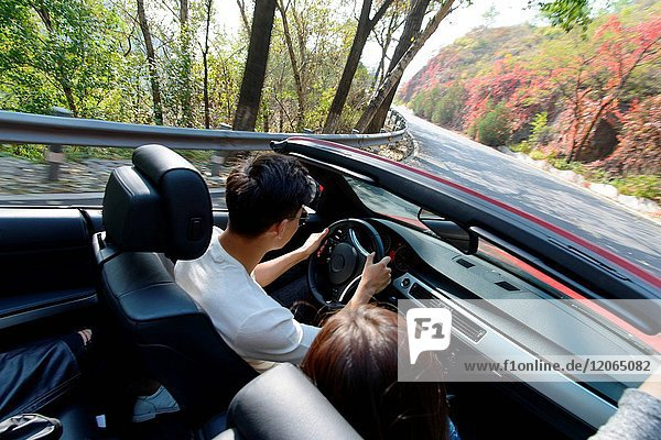 Young men and women driving out to travel