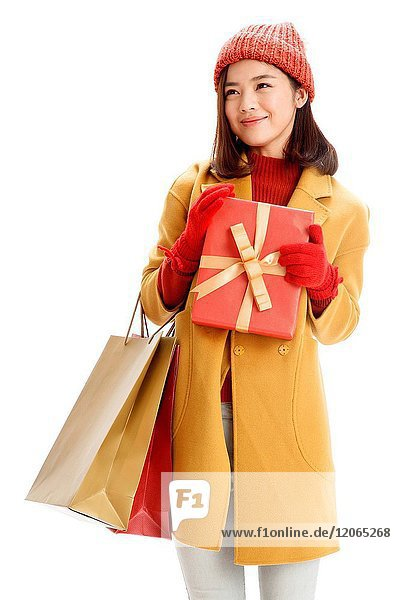 A young woman with a gift box