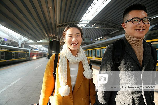 Young lovers at the railway station
