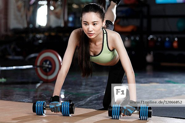 Young women exercise at the gym