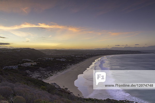 Robberg Nature Reserve and Plettenberg Bay at sunset  Western Cape  South Africa  Africa