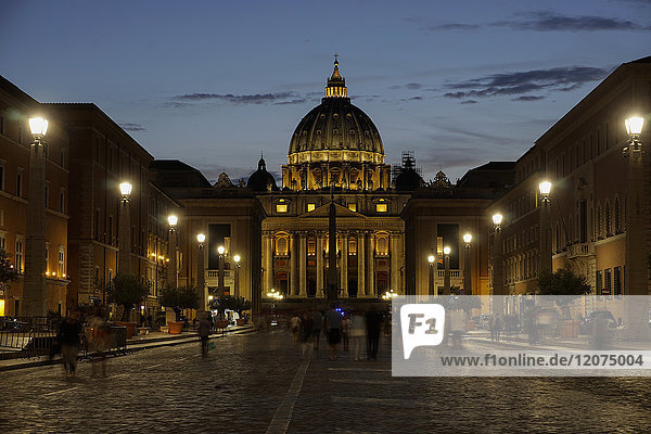 St. Peter's Cathedral night view with passing crowd  from Via della Conciliazione  Rome  Lazio  Italy  Europe