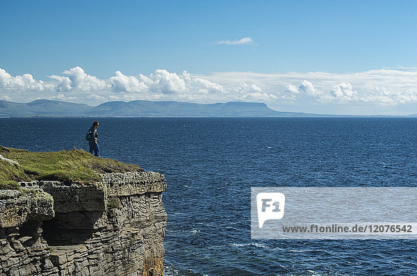 Ireland  Donegal County  Muckross Head  Woman standing on top of cliff