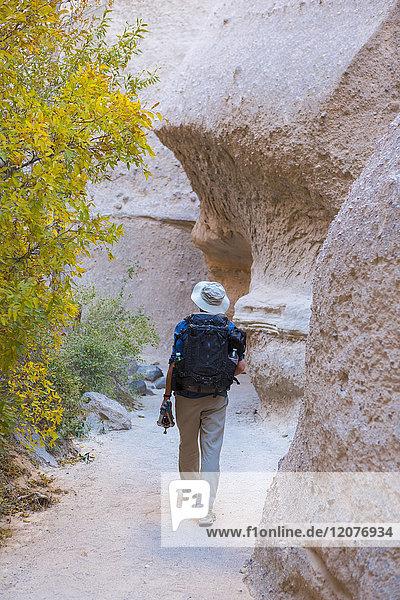 Caucasian man hiking near boulders