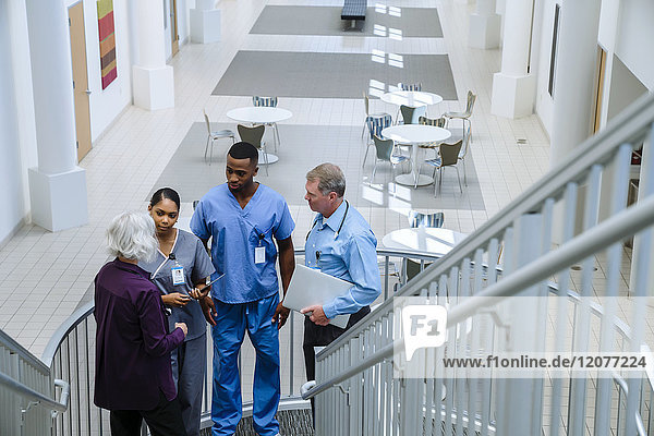 Doctors and nurses talking on staircase