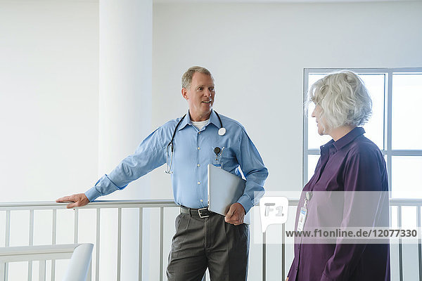 Caucasian doctors talking