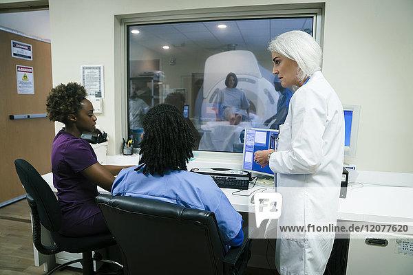 Doctor talking to nurses near scanner