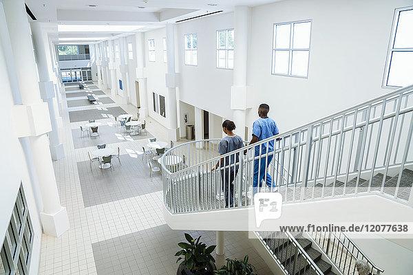 Nurses descending staircase