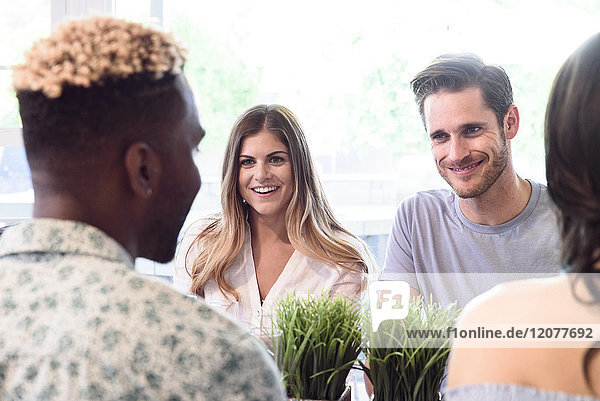 Friends smiling and talking