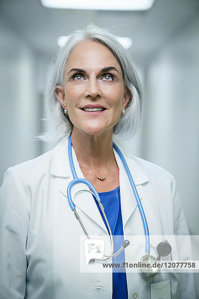Smiling Caucasian doctor looking up