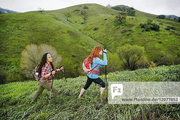 Women hiking with walking sticks