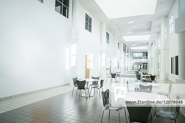 Empty table and chairs in lobby