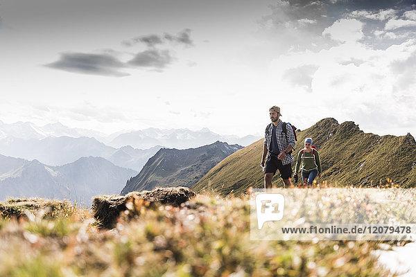 Germany  Bavaria  Oberstdorf  two hikers walking on mountain ridge