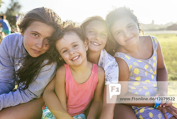 Group picture of four girls head to head at backlight