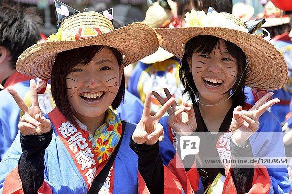 Portrait of two japanese women during Golden Week Parade  Fukuoka  Japan  Asia.