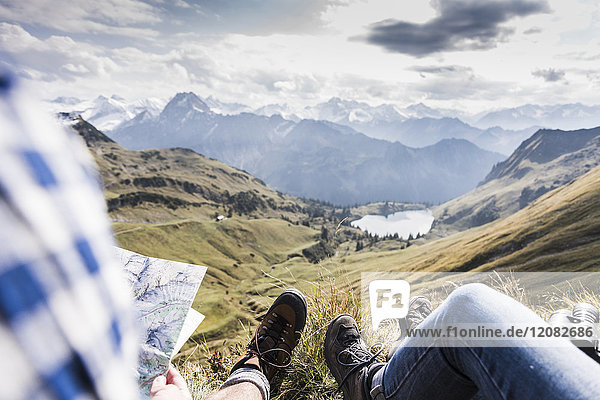 Germany  Bavaria  Oberstdorf  two hikers with map resting in alpine scenery