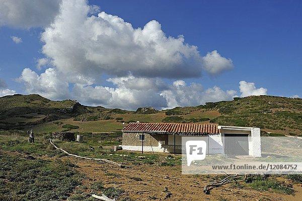 Fisherman house at Cala Mica inlet near Cape Cavalleria on the North Coast of Menorca  Balearic Islands  Spain  Europe.