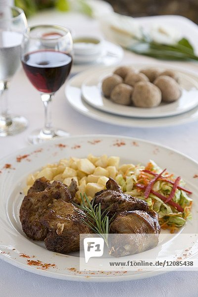 Rabbit dish  together with wrinkled potatoes and washed down with local wines. Isla de El Hierro. Canarias.