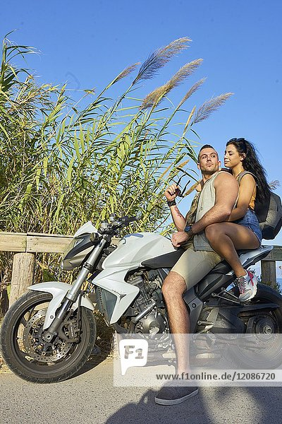 Young couple together on motorbike. Greek ethnicity. In holiday destination Hersonissos  Crete  Greece