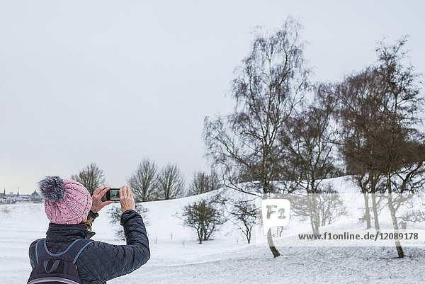 Germany,  Bavaria,  Munich,  Olympiapark with snow and photographer,  MR-GER-17-001.
