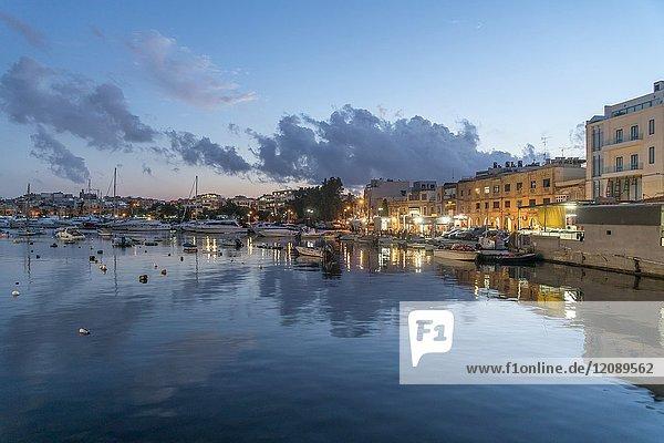 Promenade The Strand and harbour in Sliema near Valletta at dusk  Malta.