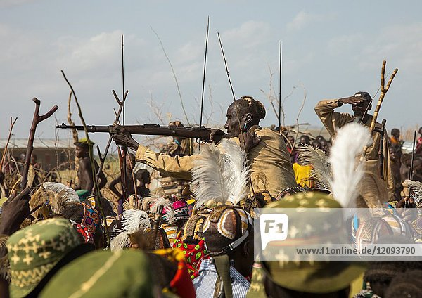 Man shooting with a kalashnikov during the proud ox ceremony in the Dassanech tribe  Turkana County  Omorate  Ethiopia.