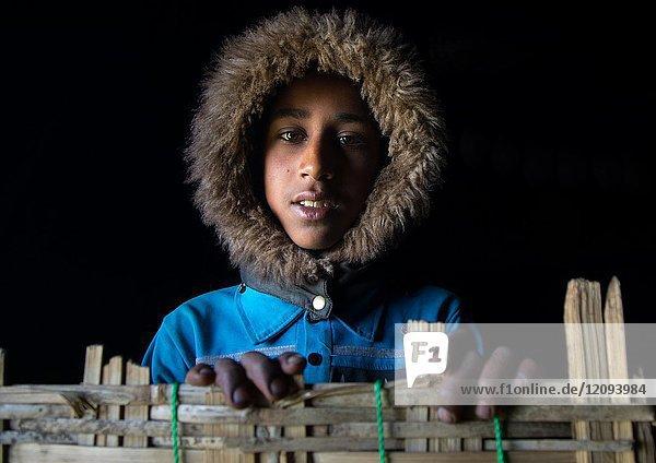 Gurage tribe boy with a rain hood in a house  Gurage Zone  Butajira  Ethiopia.