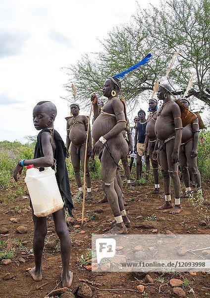Bodi tribe fat men during Kael ceremony  Omo valley  Hana Mursi  Ethiopia.