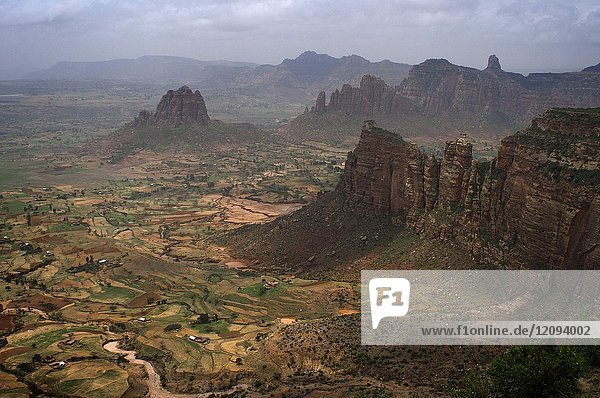 Gheralta mountains  near Hawzen  Eastern Tigray  Ethiopia. View from one of the peaks of the surrounding Gheralta mountains. In this region of mountains and canyons there are more than thirty attractive and peculiar churches carved on the rocky walls or in caves  the greatest concentration of the whole country. It is a very little visited but tremendously interesting and beautiful area  whose best exploration base is the town of Hawzen.