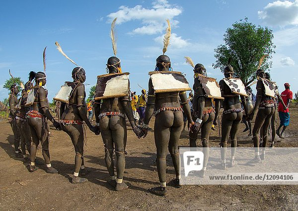 Bodi tribe fat men during Kael ceremony  Omo valley  Hana Mursi  Ethiopia.