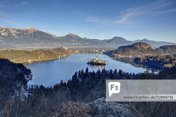 Elevated view of Lake Bled and the Church of Mary the Queen  located on a small island in the middle of the lake  Bled  Slovenia.