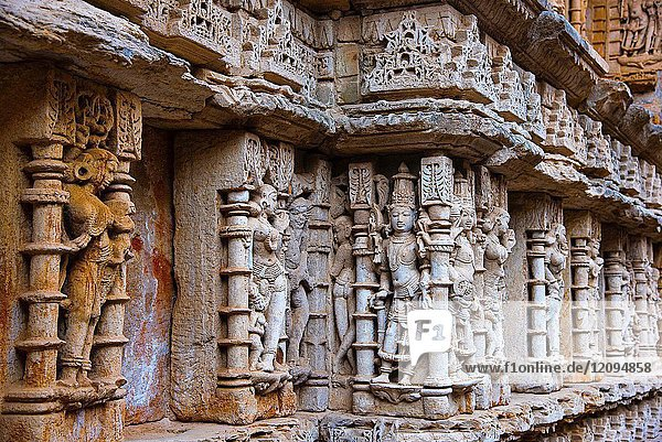Carved idols on the inner wall and pillars of Rani ki vav  an intricately constructed step well. Patan in Gujarat  India.