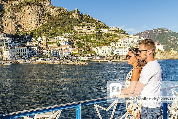 Amalfi  Amalfi coast  Salerno  Campania  Italy. Couple admires the sunset at Amalfi.