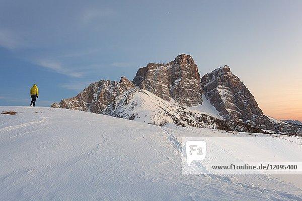 Hiker in front of Pelmo from Col Roàn  Dolomites  Fiorentina Valley  Belluno  Borca di Cadore  Belluno  Veneto  Italy.