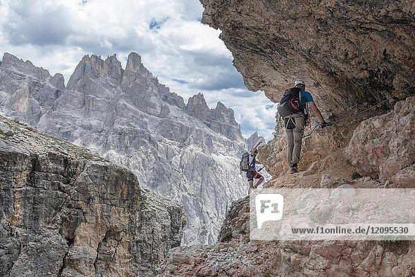 Climbers on the via ferrata Cengia Gabriella  Popera group  Giralba  Sexten Dolomites  Belluno  Veneto  Italy.