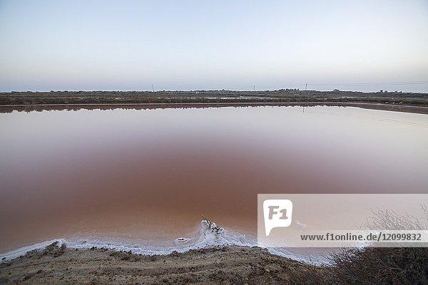 Sunset in Tavira salt ponds Algarve  Portugal.
