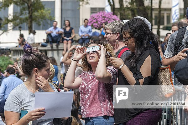 Thousands of the curious congregate in Bryant Park to watch the partial solar eclipse occurring in New York on Monday  August 21  2017. New York City is not in the path of totality with the moon covering only almost 72 percent of the sun during the 2:44PM peak.