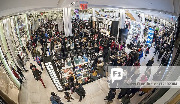 Hordes of shoppers throng the Macy's Herald Square flagship store in New York looking for bargains on the day after Thanksgiving  Black Friday  November 24  2017. Many retailers have spread 'Black Friday' over the Thanksgiving week  including opening on Thanksgiving Day  thinning some of the crowds that traditionally mobbed the stores. (© Richard B. Levine).