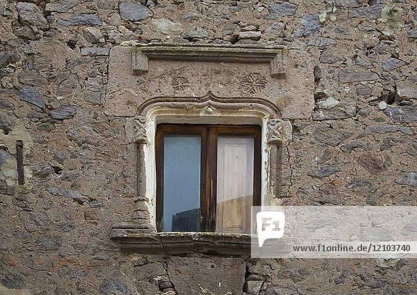 An old window with a 15th century stone architrave in the old village of Bortigali  Sardinia  Italy.