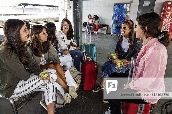 Portugal  Coimbra  Coimbra B  Comboios de Portugal  railway  train  station  platform  girl  teen  sitting  waiting  young adults  friends
