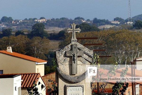 The view from a cemetery of a cross and the Peyne river valley  Pézenas   Herault  France.